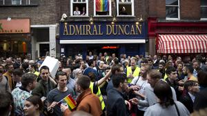 People gather outside the Admiral Duncan pub in Soho (AP)