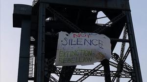 The protestors hung banners on the Finnieston Crane and at the City Chambers (Extinction Rebellion/PA)