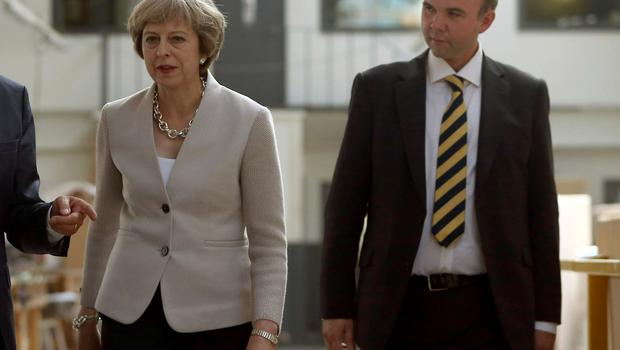 Gavin Barwell pictured with his former boss, Theresa May (Neil Hall/PA)