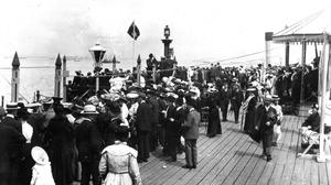 People watching the arrival of the French fleet from Ryde pier, as the 200th anniversary of the opening of Britain's first seaside pier, Ryde pier on the Isle of Wight, is being marked today.