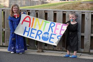 Children hold a banner outside Aintree University Hospital in Liverpool (Peter Byrne/PA)