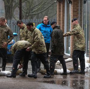 The Duke of Cambridge helped oldiers, police and firefighters load up sandbags onto a lorry in Datchet, Berkshire to help to defend the town from the floods