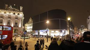 Piccadilly Circus in London after the screens were switched off for an hour (WWF/PA)
