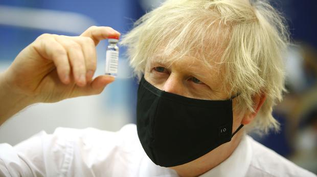Boris Johnson holding a vial of the Oxford/AstraZeneca Covid-19 vaccine (PA)