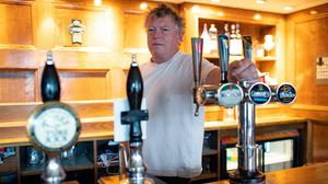 John Turner, landlord of The Dolphin pub in Llanymynech, where the border for England and Wales runs along the A483 (Jacob King/PA)