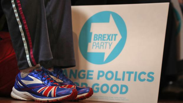 People wait for Brexit Party leader Nigel Farage to speak at an event in Barnsley (Danny Lawson/PA)