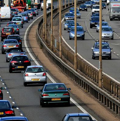 Travellers faced tailbacks as police closed a stretch of one of the UK's busiest motorways