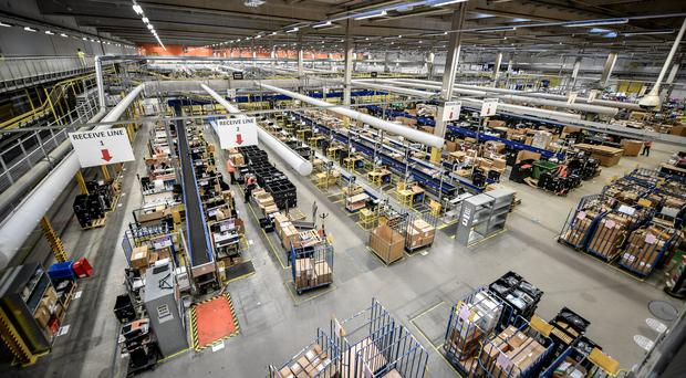 Amazon has urged more people to visit its fulfilment centres as part of a transparency drive (Ben Birchall/PA)