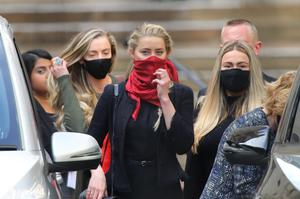Amber Heard leaves the High Court (Aaron Chown/PA)
