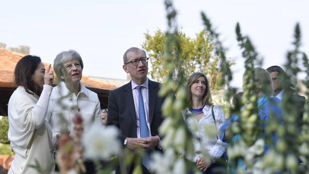 Theresa May and her husband Philip during the press day for this year's RHS Chelsea Flower Show (Jonathan Brady/PA)