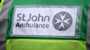Detail of a St John Ambulance worker's uniform (Clive Gee/PA)