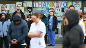 Staff stand outside the Royal Derby Hospital (Jacob King/PA)