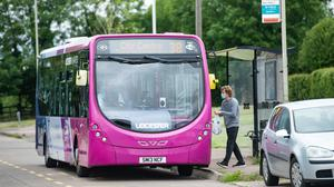 Emergency Covid-19 funding for bus and tram operators in England is being extended ahead of expected increases in demand next month, the Government has announced (Jacob King/PA)