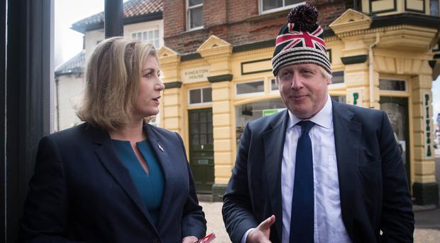 Boris Johnson and Penny Mordaunt (Stefan Rousseau/PA)