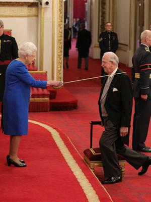 Sir Boyd Tunnock is knighted by the Queen (PA)
