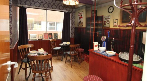 A memories pub complete with replica beer taps and vintage posters at Wirral's Arrowe Park hospital (NHS/PA)
