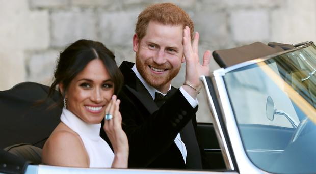 The newly married Duke and Duchess of Sussex leaving Windsor Castle after their wedding for Frogmore House (PA)