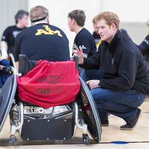 Prince Harry talks to veterans playing murder ball in wheelchairs during a visit to the Help For Heroes gym at Tedworth House in Tidworth, Wiltshire