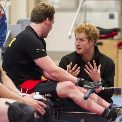 Prince Harry talks to veteran Jonathon Le Galloudec on a rowing machine during a visit to the Help For Heroes gym at Tedworth House in Tidworth, Wiltshire