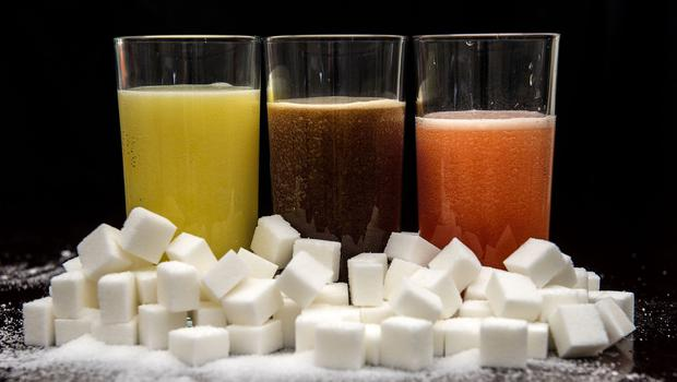 Consumption of sugary drinks should be limited to help prevent cancer, scientists have said (Anthony Devlin/PA)