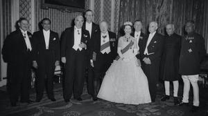 Queen Elizabeth II with Commonwealth Prime Ministers at Buckingham Palace, London. Left to right; Sir Godfrey Huggins (Central Africa Federation); Mohammed Ali (Pakistan); Robert Menzies (Australia); Charles Swart (South Africa's Minister of Justice); Sir Winston Chruchill; Sidney Holland (New Zealand); Luois St. Laurent (Canada); Pandit Jawaharlal Nehru (India); and Sir John Kotelawala (Sri Lanka).