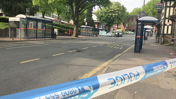 The scene where a 16-year-old was pronounced dead in Lower Parade (Phil Barnett/PA)