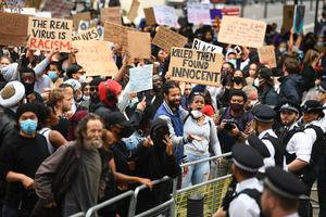 Demonstrators at a Black Lives Matter protest rally outside the gates of Downing Street (Victoria Jones/PA)