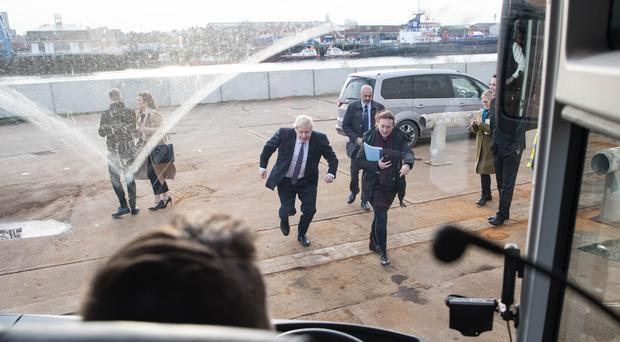 Boris Johnson makes his way towards his battle bus while on the campaign trail (Stefan Rousseau/PA)
