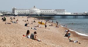 People on the beach during the warm weather in Brighton (Gareth Fuller/PA)