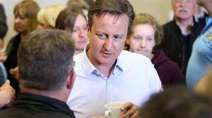 Prime Minister David Cameron (centre) meets supporters during the General Election campaign trail in Addingham in West Yorkshire.