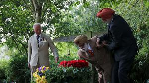 Second World War veteran Darbara Singh Bhullar, 97, lays a wreath during the national service of remembrance (Molly Darlington/PA)