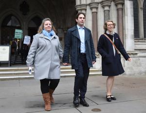Rebecca Steinfeld and Charles Keidan with their solicitor Louise Whitfield (Charlotte Ball/PA)
