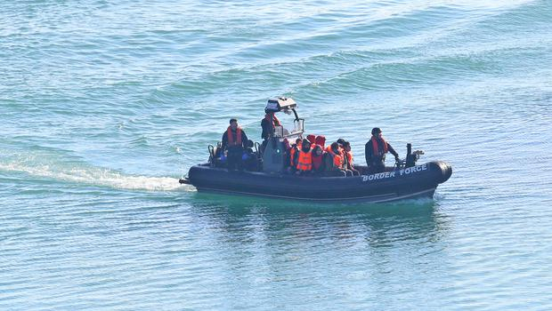 A Border Force boat returns to Dover, Kent, carrying people thought to be migrants (Gareth Fuller/PA)