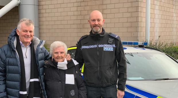 Florence Rudd, a lifelong Newcastle fan, stands next to a police car (Special Constable Ryan Young)