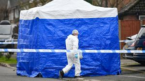 Forensic officers at the scene in Duffield, Derbyshire (Jacob King/PA)