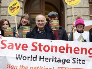 Tony Robinson (centre) and the Stonehenge Alliance protest against road building plans for the Stonehenge World Heritage Site (Yui Mok/PA)