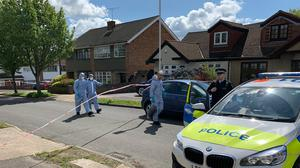Police forensic officers at the scene in Kerry Drive, Upminster, east London (Tom Pilgrim/PA)