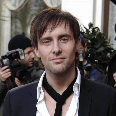 """Steps singer Ian """"H"""" Watkins has won an apology after his picture was used on a story about the Lostprophets musician of the same name."""
