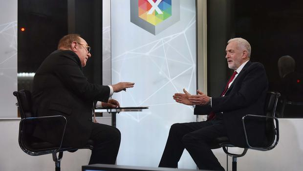 Andrew Neil with Labour Party leader Jeremy Corbyn during a BBC interview (Jeff Overs/BBC/PA)