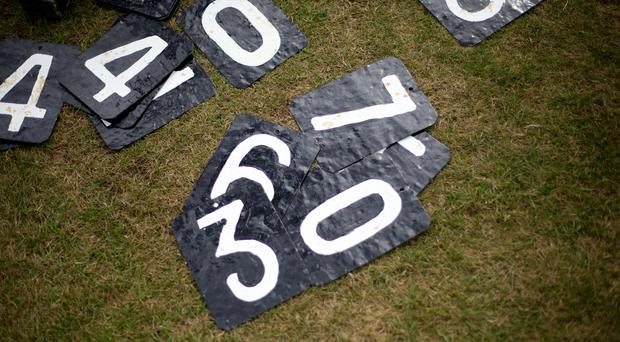 Scoreboard numbers lay on the ground at Blenheim Park Cricket Club (PA)