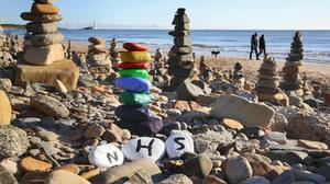 A pebble stack in recognition of the NHS on the beach at Whitley Bay (Owen Humphreys/PA)