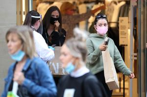 Shoppers in Glasgow where face coverings are already mandatory in stores (Andrew Milligan/PA)