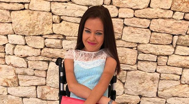 Gamma Quinn has been stranded in Singapore after the back of her wheelchair was lost on an Emirates flight from Manchester to Dubai (Mike Quinn/PA)