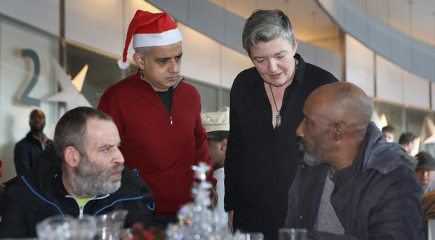Mayor of London Sadiq Khan speaks to St Mungo's charity service users Anthony Kyriacou (front left) and Micheal Scott (front right) with director of rough sleeping services Petra Salva (Phil Toscano/PA)