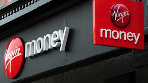 Virgin Money has halted plans to axe around 500 jobs and shut or merge more than 50 branches (Rui Vieira/PA)