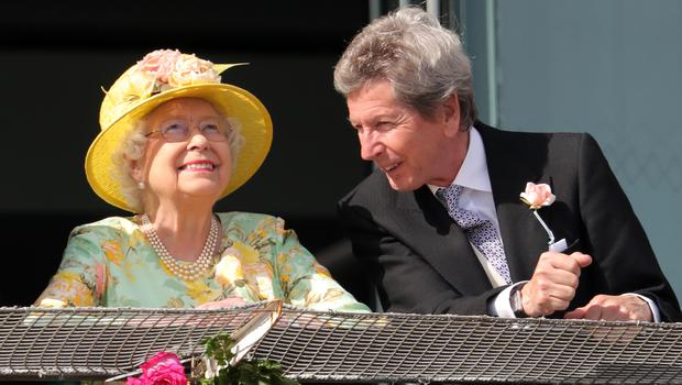 The Queen with her racing manager John Warren - Zalie's grandfather - on Derby Day (Andrew Matthews/PA)