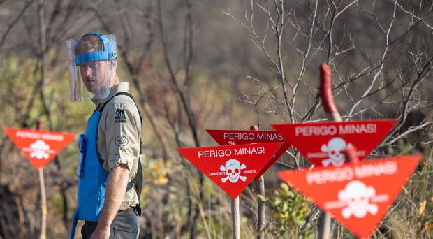 The Duke of Sussex walks through a minefield in Dirico, Angola (PA)