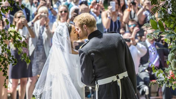 Meghan Markle and Prince Harry kiss on the steps of St George's Chapel (Danny Lawson/AP)