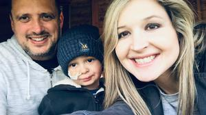 Undated family handout file photo of Claire and Michael Scott, with their son Liam. A footballer who has made it his mission to send the four-year-old boy to the US for life-saving treatment is set to take on the English Channel – by kayak.