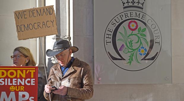 Protesters outside the Supreme Court in London (Kirsty O'Connor/PA)
